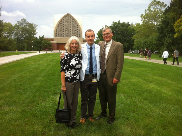 David at his white-coat ceremony with his parents.